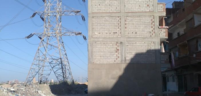بالصور.. بناء دون ترخيص تحت أبراج الضغط العالي بالإسكندرية 📷