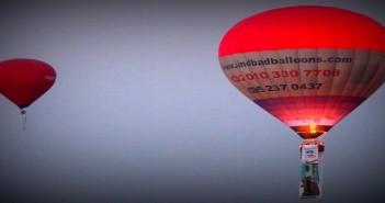 البالون يحلق في سماء الأقصر بصور السيسي احتفالا بقناة السويس الجديدة