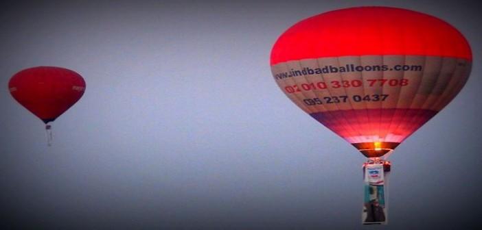 📷 «البالون» يحلق في سماء الأقصر بصور السيسي احتفالاً بقناة السويس الجديدة