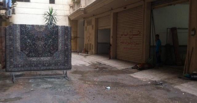 بالصور.. محل تنظيف سجاد دون ترخيص يزعج سكان في لوران بالإسكندرية