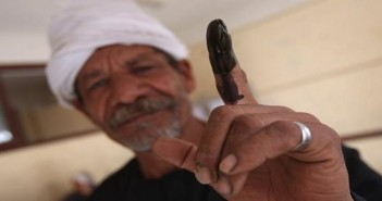 FAIYUM, EGYPT - MAY 23:  A voter shows off an ink-stained finger after voting in Egypt's presidential election on May 23, 2012 in Faiyum, Egypt. Some 50 million Egyptians were registered to vote in the first presidential election of the post-Mubarak era. Voting takes place Wednesday and Thursday, but could go to a second round June 16-17 if no candidate wins an outright majority of the vote.  (Photo by John Moore/Getty Images)
