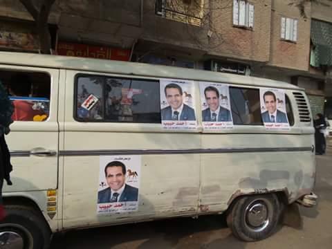 دعاية انتخابية وميكروباصات للمرشحين أمام لجان بدائرة العمرانية