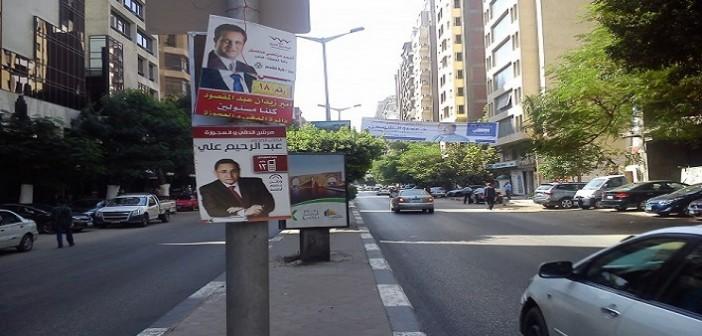 بالصور.. حرب اللافتات بدائرة الدقي والعجوزة تستبق «الصمت»: 34 مرشحًا من أجل مقعدين 📷