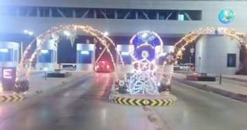 تزيين بوابة طريق مصر ـ الإسكندرية الصحراوي احتفالا بالمولد النبوي