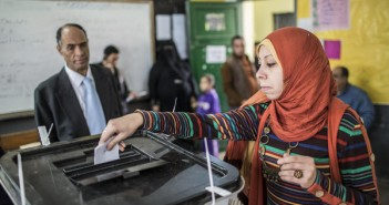 CAIRO, EGYPT - DECEMBER 15: An Egyptian woman casts her vote during a referendum on the new Egyptian constitution at a polling station on December 15, 2012 in Cairo, Egypt.  Egyptians went to vote in the first stage of the referendum on a draft constitution, which has caused controversy and led to bitter division between liberals and Islamists. (Photo by Daniel Berehulak/Getty Images)