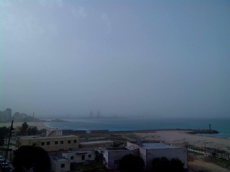 نوة ترابية وأجواء غائمة بالإسكندرية