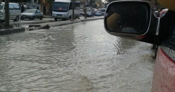 صور.. غرق ميدان الكيلو 21 في العجمي بالإسكندرية في مياه الأمطار