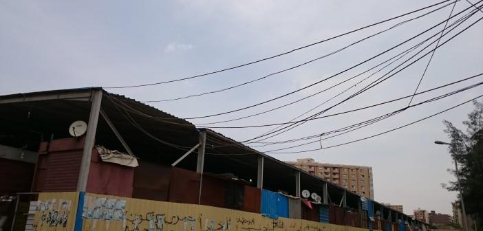 بعد إزالة إشغالات الباعة.. سرقة كهرباء بسوق حلوان الجديد (صور)