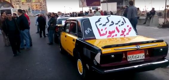 📷| سائقو تاكسي الإسكندرية: «أوبر وكريم خربوا بيوتنا»