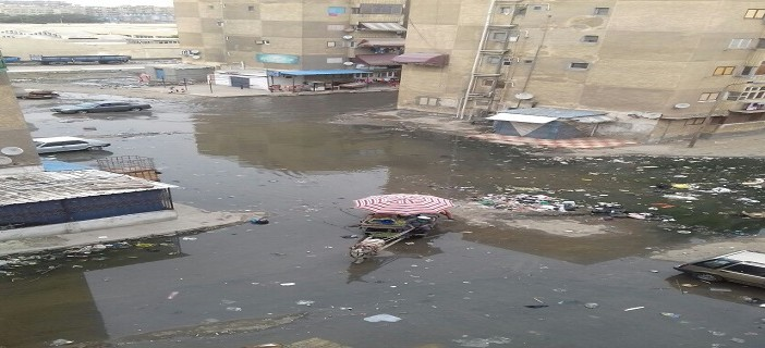 📷 غرق «مساكن النصر» في بورسعيد في الصرف والقمامة (صور)