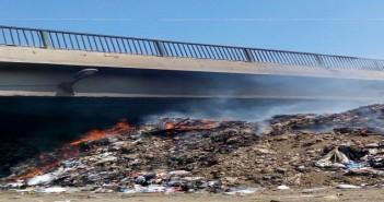 مواطنون يشتكون من حرق القمامة أسفل الدائري فى غياب المسئولين (صور وفيديو)