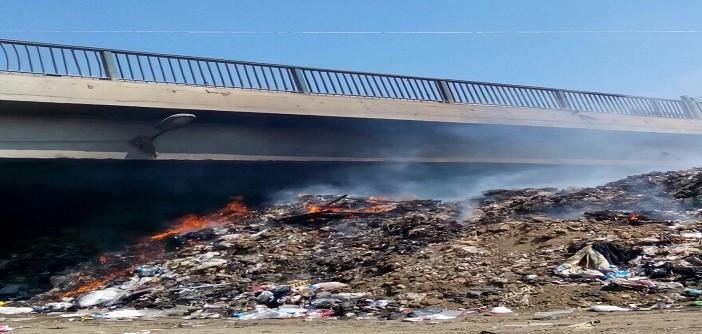 مواطن يرصد تفاقم أزمة القمامة وحرقها أسفل الدائري (فيديو)