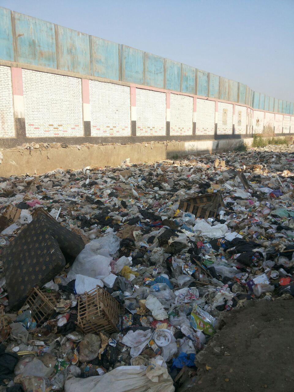 تجمعات للقمامة قرب مترو جامعة القاهرة (صور)
