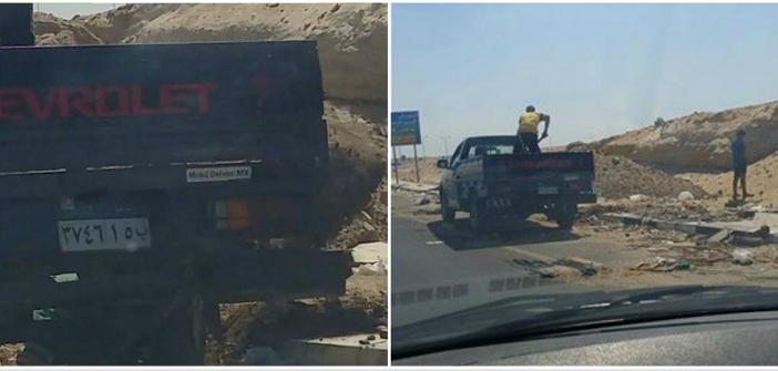 بالصور.. سيارة شرطة تفرغ مخلفات البناء بمسار دراجات محور المشير