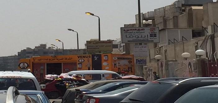 الميكس الـ … أعمدة إنارة مضاءة نهارًا بمدينة نصر.. وأسفلها منفذ لمبات موفرة (صور)