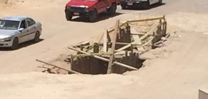 سكان زهراء المعادي: حُفر الصرف الصحي مصائد موت للمواطنين (صورة)
