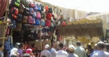 بالصور.. حملة لرفع الإشغالات بمدينة سنور محافظة الفيوم