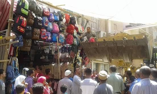بالصور.. حملة لرفع الإشغالات بمدينة سنورس بالفيوم