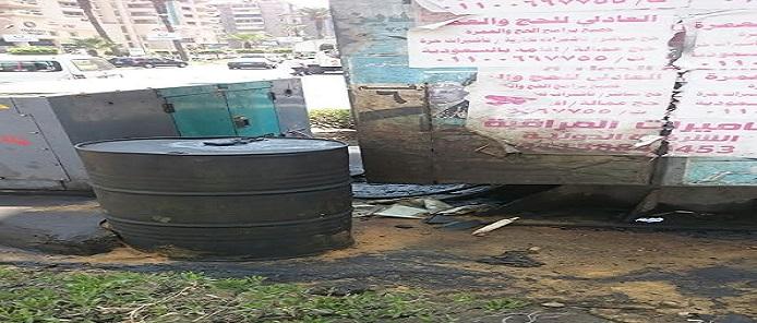 مولد كهرباء إعلان بمدينة نصر يثير المخاوف بسبب انتشار الوقود حوله (صور)