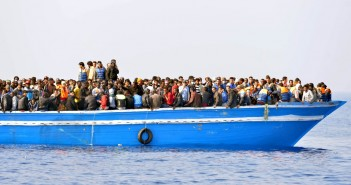 "Migrants stranded on a boat, thirty miles off the Libyan coast as they are rescued by Royal Marines.  PRESS ASSOCIATION Photo. Picture date: Sunday June 7, 2015. The rescued migrants were taken to the Royal Navy ship where they were searched and processed before being handed over to the Italian authorities. Britain is a country that ""doesn't walk on by"", David Cameron said as HMS Bulwark undertook another rescue mission off Libya. The Royal Navy warship picked up at least 500 migrants found in four boats in the seas off the north African country. Arriving at the G7 summit in Garmisch-Partenkirchen, Germany, the Prime Minister said the flagship had been deployed because the UK is a ""country with a conscience"".  But he warned that the causes of the mass exodus from Libya must be dealt with, not just the consequences. See PA story DEFENCE Migrants. Photo credit should read: Rowan Griffiths/Daily Mirror/PA Wire"