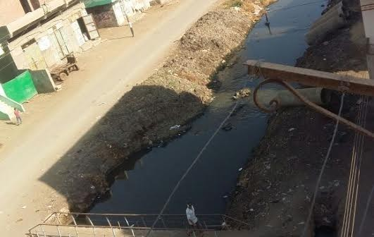 أهالي «الأورمان» يطالبون باستكمال ردم مصرف القرية: تسبب في إصابة 200 بفيرس سي (صور)