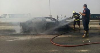 بالصور.. احتراق سيارة على المحور في اتجاه المهندسين القادم من الشيخ زايد
