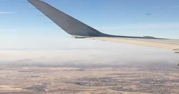 صور جوية.. مواطن يرصد تلوث دخان مصانع الطوب في حلوان من الطائرة