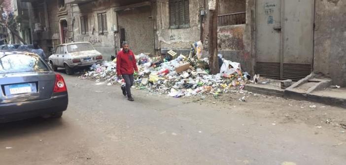 استياء من تجمعات القمامة بشوارع في الدقي (صور)