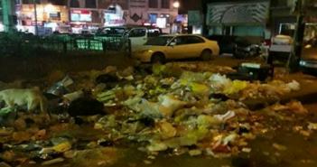 القمامة بميدان النمسا في السويس