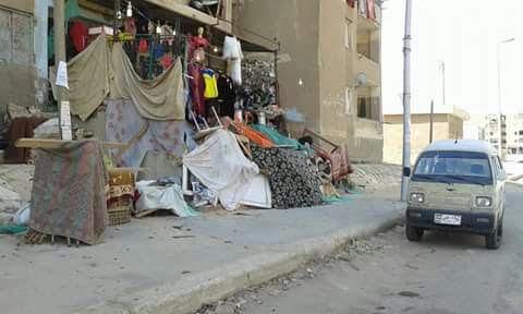 سكان القاهرة الجديدة يشكون انتشار المخالفات بشوارع المدينة (صور)
