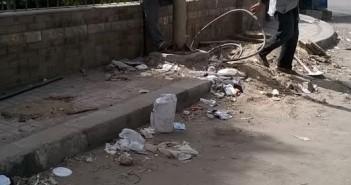 سكان حي «الطلبة» بالجيزة يطالبون بتغيير أعمدة الكهرباء القديمة(صور)