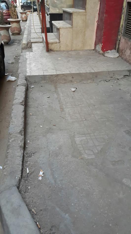 سكان بمصر الجديدة يشكون انتشار القمامة وإشغالات الطرق (صور)