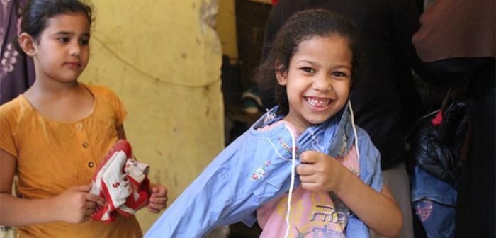 بالصور.. معرض ملابس لـ«مصر بتاعتي» في عزبة الهجانة
