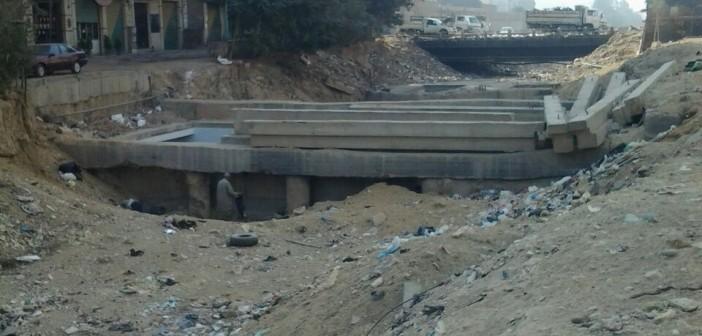معاناة مستمرة لسكان شارع حيوي بزهراء المعادي بعد تكسيره (صور)